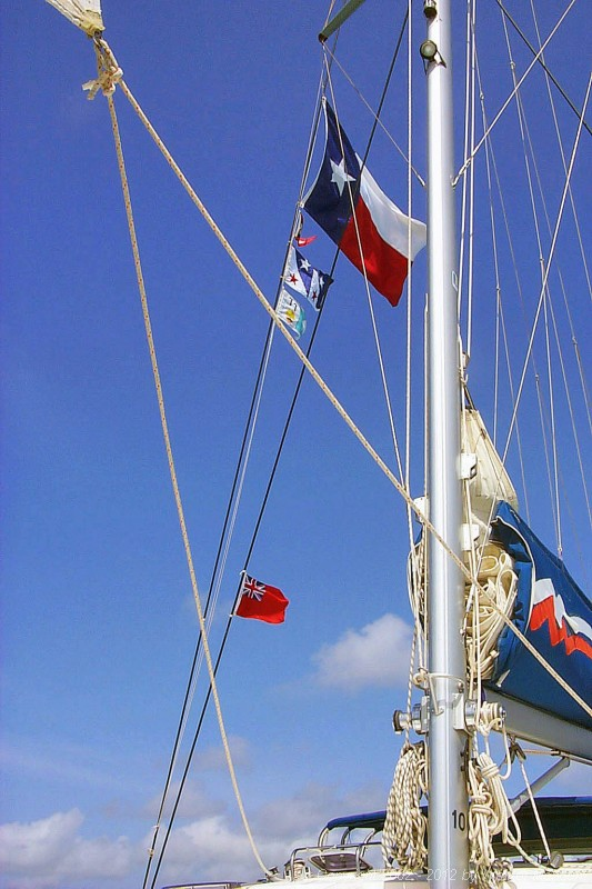 Our flags. From top to bottom, we have the Texas state flag, the Houston Yacht Club burgee, our Mangum personal flag, and the TravelTalk Online flag.