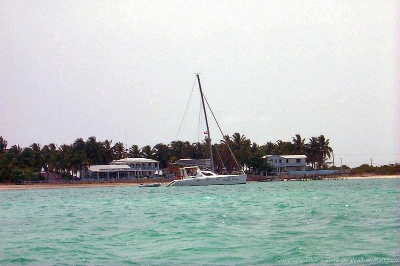 A view of Neptune's Treasures house as seen from our kayak as we paddled from the Anegada Reef Hotel anchorage around the west end of Anegada to Cow Wreck Beach. The catamaran is Calypso Queen, on which Stinky and The Judge were spending their honeymoon on a crewed charter with Mike and Jennifer Kneafsey as their captain and first mate.