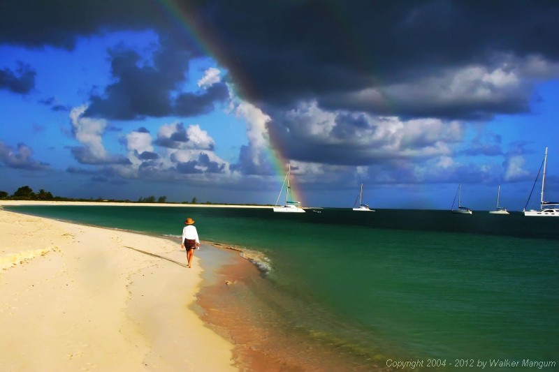 Cele and a rainbow over Pomato Point. Sea Breeze at the end of the rainbow, Sea Leopard on the right. This photo made the cover of BVI Welcome Magazine!