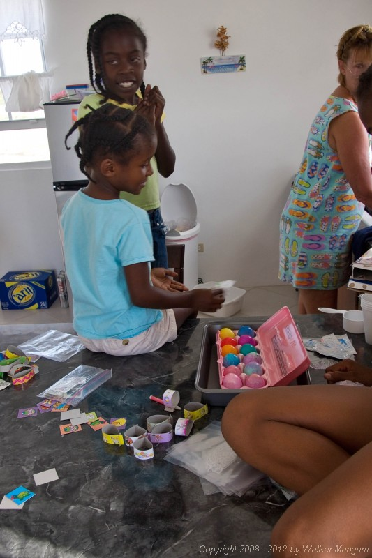 Dyeing Easter eggs with Trayesha, Janesha, and Lakesha.